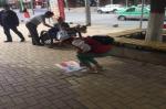 志愿服务活动(四)南川分局在南小街沿线开展文明劝导志愿服务活动 - 公安局